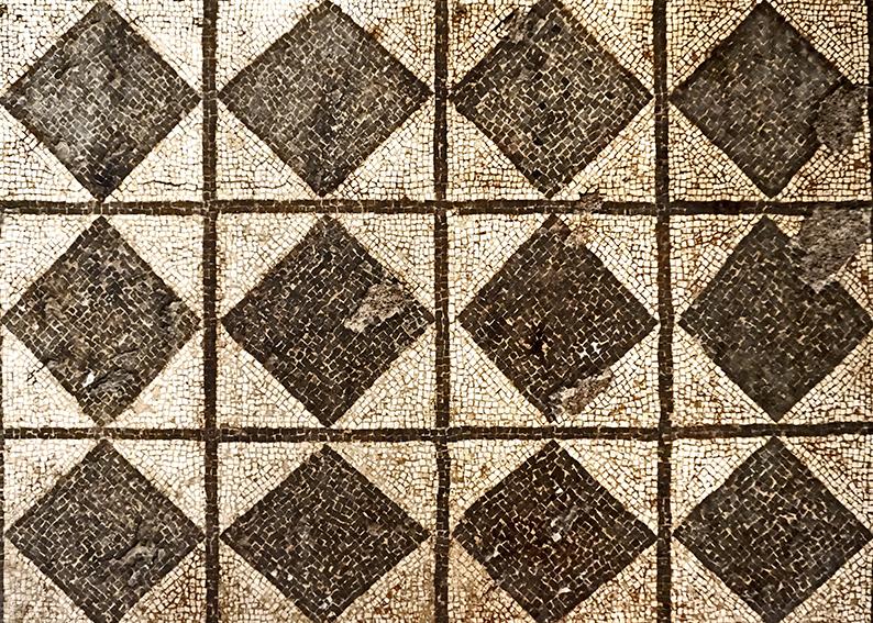 Mosaic amb un patró de quadrats i rombs en blanc i negre. Mosaics del Museu Arqueològic de Tarragona