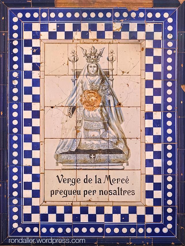 Corbera de Llobregat, Baix Llobregat. Plafó ceràmic de la Verge de la Mercè a la Casa Homs.