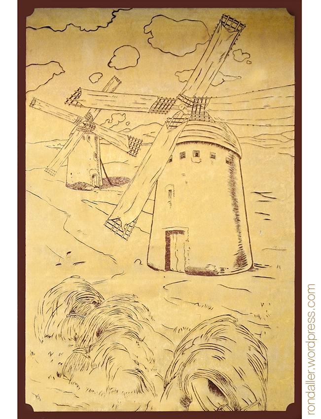 Esgrafiats de molins de vent a la farinera Sant Jordi de Vic (Osona).