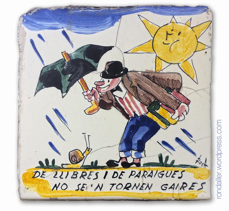 De llibres i de paraigües no se'n tornen gaires. Rajoles humorístiques d'Anton Roca a Calella. Restaurant La Quadra.