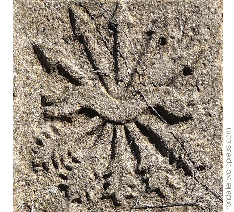 Símbol del jou i les fletxes.