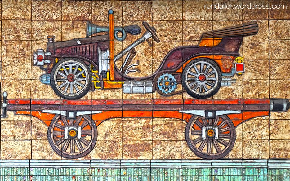 Vagó transportant un cotxe d'època al Mural de Joan Rifà a Mataró.