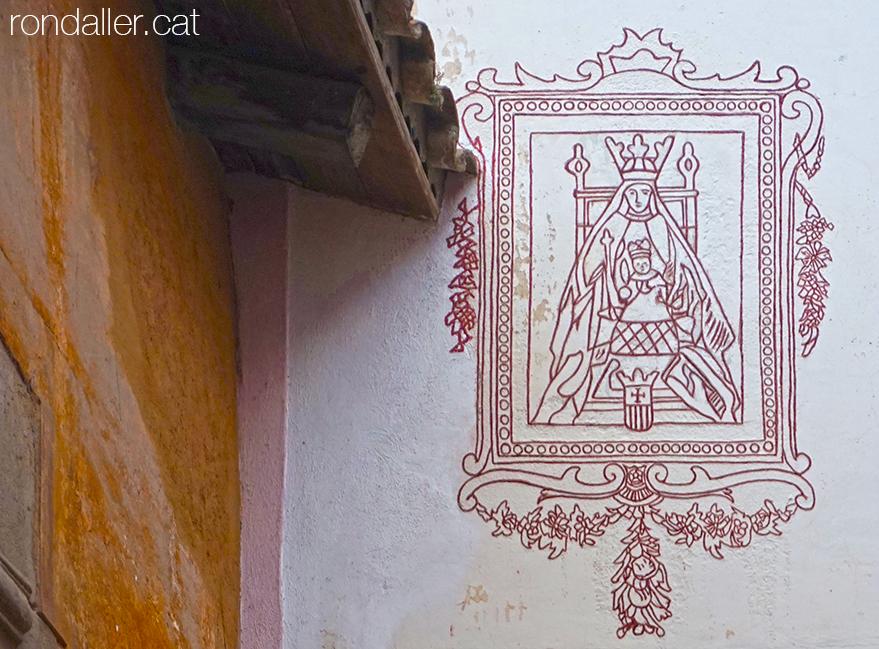 Sagrera de Sant Feliu de Codines. Esgrafiat de la Mare de Déu de la Mercè en un racó.