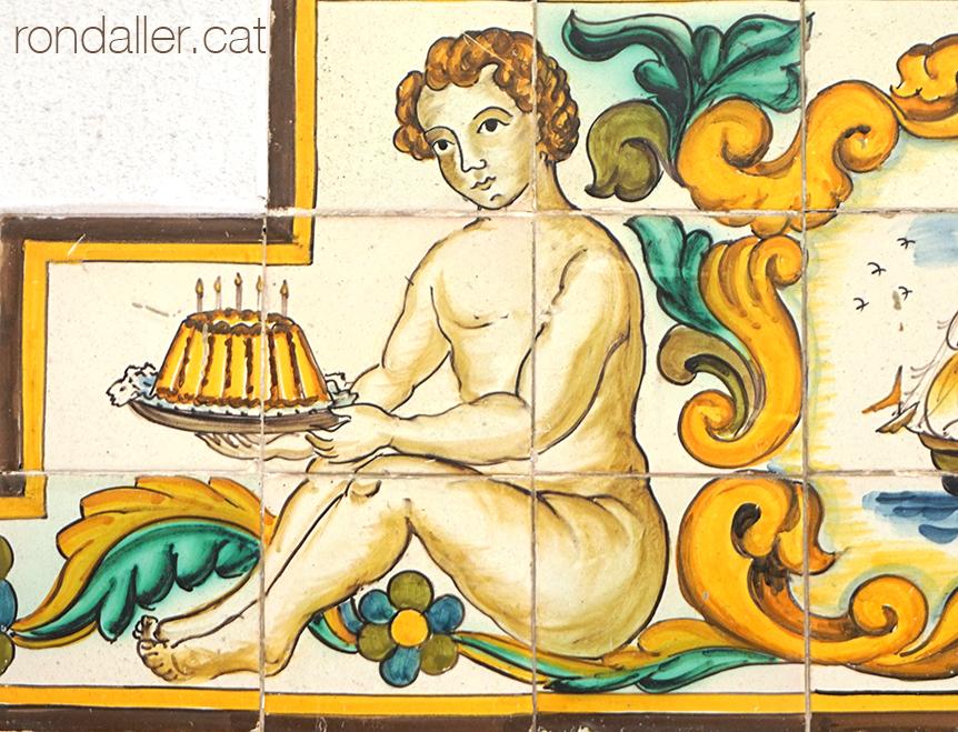 personatge amb un flam a la pastisseria Tomàs de Tossa de Mar.
